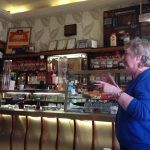 Photo of Betty Skelton in mid story in front of the counter at Jaconelli's Ice Cream Parlour, Maryhill