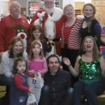 Photo of Betty with storytelling friends and Santa at Woodlands Library
